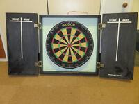 Dart board in cabinet with scoring boards