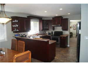 SAFE AND CLEAN newer home 5 bed 2 bath with Double Garage AND WO