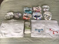 24 Bummis reusable organic cloth nappies in two sizes, plus outer wraps, liners and fasteners
