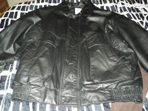 mans black leather jacket wit zip out lining