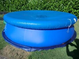 12 ft inflatable swimming pool with filter, pump and cover.
