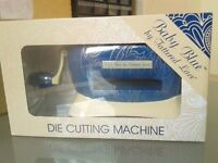 Baby Blue die cutting machine. For small dies. Takes up very little desk space. New