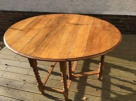 Antique oak leaf dining table