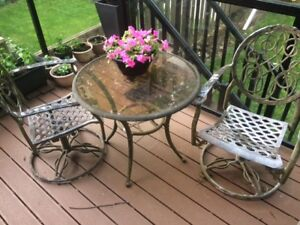 Patio Set - 2 Glass Tables - 2 Swivel Chairs - 6 Chairs - $50