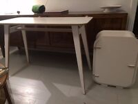 Stylish white table and cabinet