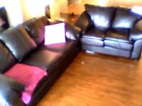 BLACK LEATHER COUCHES WITH BLUE UNDERGLOW