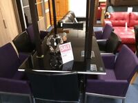Uno black glass table and 4 chairs