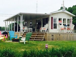 Waterfront! 12'x38' Park Model, wrap around deck & private dock