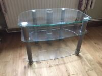 TV Stand - clear glass 70cm wide front, 40 cm wide back 46 cm deep