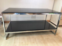 Double dark glass table suitable for bedroom or lounge
