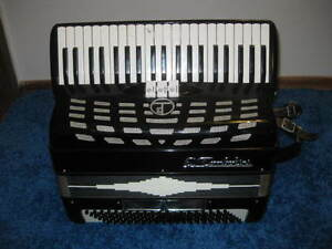 E. Tombolini - 120 bass 41 key Accordion w/new straps - $350 obo