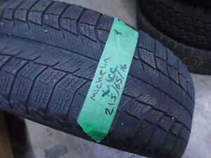 FOUR USED WINTER 215-65-16 { MICHELIN-X-ICE } R.H AUTO