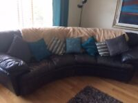 black leather corner settee. Great condition. Curved rather than 90 degree corner shape