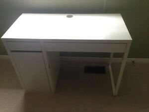 IKEA desk with drawers and shelves.
