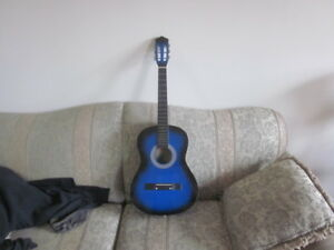 blue acoustic 6 string guitar