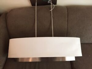 White oval fabric shade, 3 bulbs and stainless steel chandelier