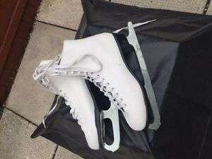 Girls Figure Skates.size 7 & 8, and Helmet
