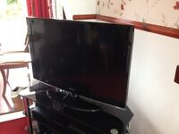 "40"" HD LED TV with surround sound system"