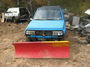1997 Suziki 4X4 with plow