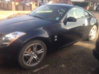 For sale left hand drive Nissan 350z 2004 black with tan interior 1 owner from new 65.6509 miles