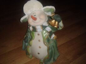 Unboxed snowman with lantern statue ornament