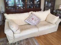 Large sofa with complete new set of removable, washable covers.