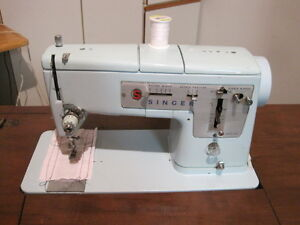 Singer Sewing Machine in Cabinet & Stool