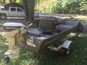 2013 Tracker Jon Boat with a 15 HP Johnson Outboard and Trailer.
