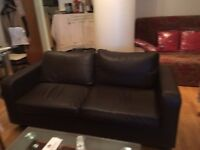 Leather - two seater sofa and one arm chair set in good condition.