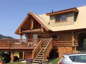 SIMPLY STUNNING....CUSTOM LOG HOME ON 62+ ACRES...!