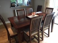 Wooden dining room table and 8 chairs - extendable from 6 to 8-seater