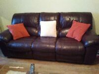 Two electric reclining leather sofas