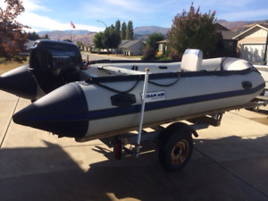 14' Ocean Air Inflatable Boat, engine, and trailer