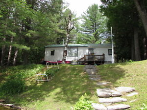 ADORABLE ~ AFFORDABLE ON GULL RIVER, 3528 Monck Rd. $299,000.