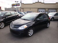 Nissan Versa 2009 usage a vendre -Kit Jupe-Toit-Mags-Bluethooth-