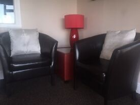 2 x Black leather chairs