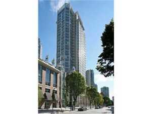 fully furnished bedroom in high-rise condo in downtown/ yaletown