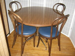 """42"""" Round Table and Four Dark Walnut Chairs"""