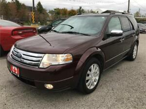 2009 FORD TAURUS X  LIMITED ,AWD,7PASS, SAFETY E-TEST