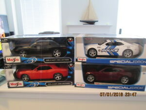 1/18 scale Camaros and challengers mint boxed