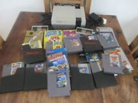 Nintendo Nes console and 11 games