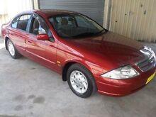 1999 Ford Fairmont AU Red 4 Speed Automatic Sedan Edgeworth Lake Macquarie Area Preview