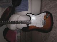 electric guitar 6 string in mint condition. complete set up for sale