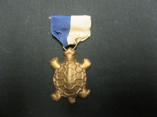 Medal with Turtle Medallion       c80