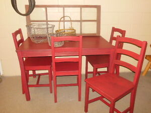 wood table and chairs in red