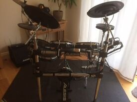 Alesis DM10 X Kit | Ten-Piece Professional Electronic Drum Set with Chrome XRack (Mylar Drum Pads)