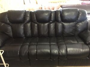 RECLINING LEATHER SOFA; WEAR ON ONE SEAT FIRST $99 TAKES IT