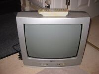 Vintage Sanyo portable TV with remote and instruction booklet