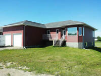 Beautiful, Large Newer Home East of Regina!