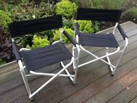 Two aluminium and black canvas folding chairs